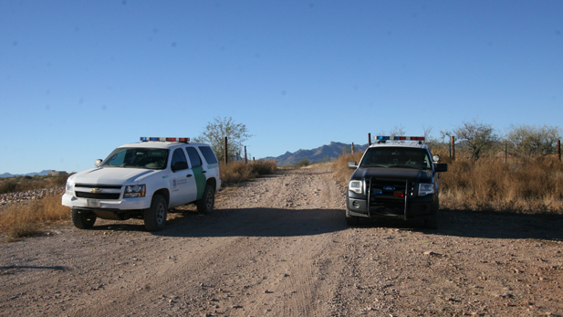 Border Patrol and Santa Cruz County Sheriff's Office vehicles blockade the entrance to a dirt road near Peck Canyon Drive and Circulo Jalapa where U.S. Border Patrol agent Brian Terry was shot, early Wednesday morning.  Terry, a BORTAC (Border Patrol Tactical Unit) agent, later died from his gunshot wounds.