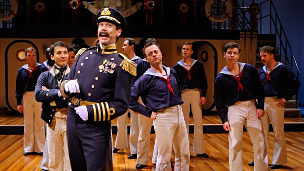 Robert O. Berdahl (Captain Corcoran) and the sailors from the cast of the Guthrie Theater's production of Gilbert and Sullivan's H.M.S. PINAFORE.