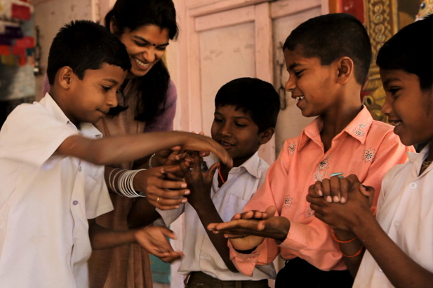 Children from a primary government school in Pachputewadi learn the hand washing song, which makes hand washing fun and ensures that all parts of the hand are washed properly.