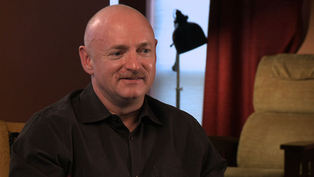 Mark Kelly says U.S. Rep. Gabrielle Giffords continues to improve, including long walks and more speaking ability.