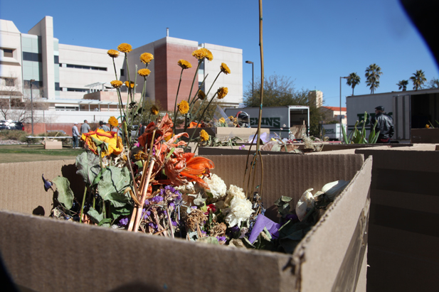 Flowers and other mementos were gathered by volunteers to be categorized and stored.