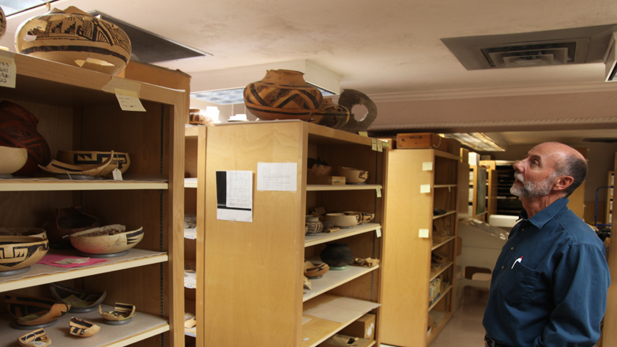 Arizona State Museum Archeology Curator Chuck Adams sizes up the museum's collection of Homolovi artifacts.