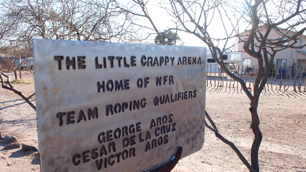 Victor Aros' scrappy front-yard sign commemorates his family's rodeo history.