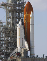 Space shuttle Endeavour glistens in the sun on Launch Pad 39A at NASA's Kennedy Space Center in Florida.