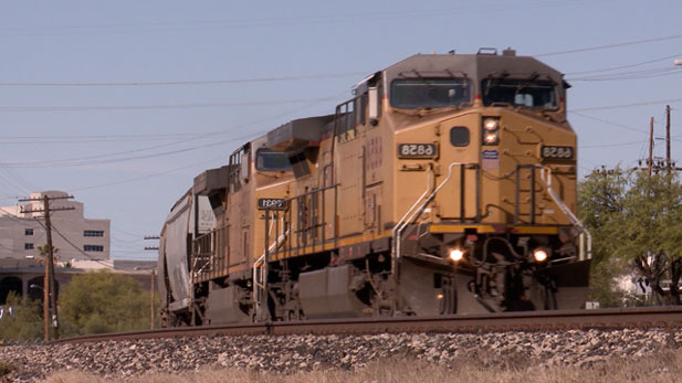 A Union Pacific freight train, pulled by two locomotives, rolls into the train yard southeast of downtown Tucson.