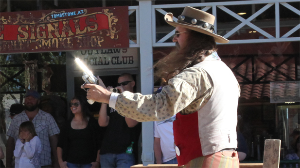 Gun metal glints in the Arizona sunshine during a gun fight reenactment.