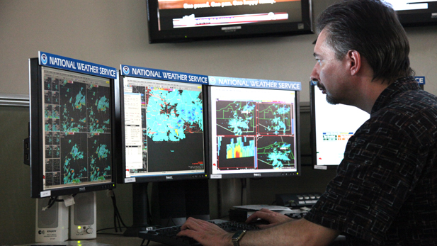 Warning Coordination Meteorologist Ken Drozd considers issuing a flood advisory.