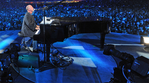"""""""Billy Joel: Live at Shea Stadium"""" captures the singer in peak form during his memorable July 2008 concerts at the historic arena prior to its demolition."""