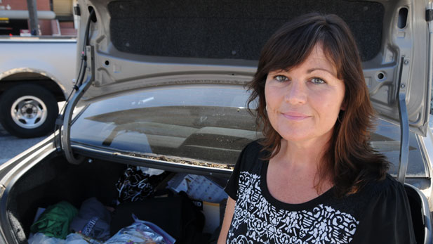 Kim Sisson keeps food, hygiene supplies and clothing for homeless youth in the trunk of her car.