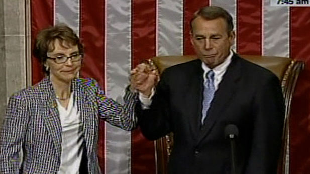 Gabrielle Giffords with House Speaker John Boehner, moments after she handed her resignation letter to him.