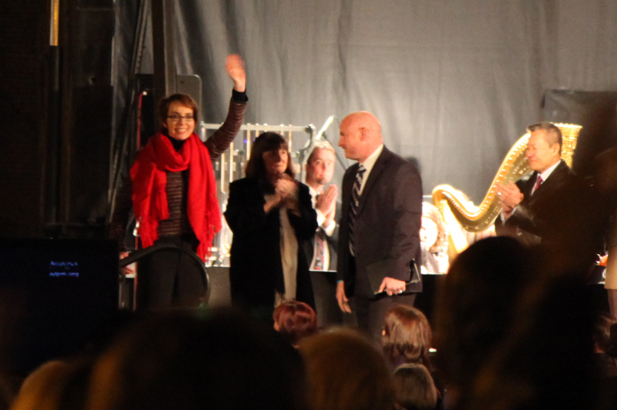 Gabrielle Giffords waving to the crowd at a Jan. 8, 2012 anniversary vigil of the shooting that took six lives and left her and 12 others wounded.