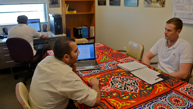 Tutor Mudhafar al-Husseini works with David Forsythe, a US Air Force ROTC student, on an Arabic assignment. Project GO, which the duo are part of, works with more than a dozen ROTC students on Arabic language and culture.