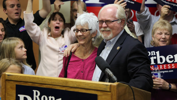 Democrat U.S. Rep. Ron Barber smiles with his wife Nancy as he declares victory in the Congressional District 2 race, Nov. 17, 2012.