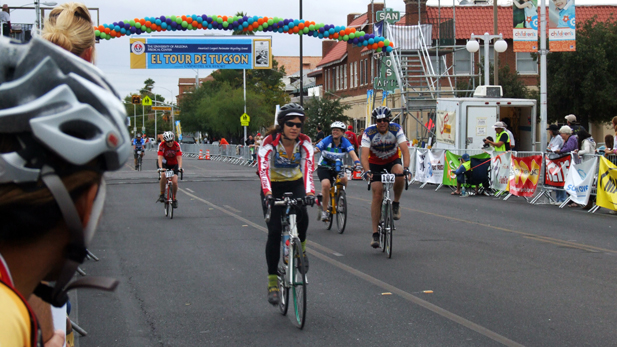 Rebecca Brukman. 11/26/12. Bikers cross the finish line at El Tour De Tucson.