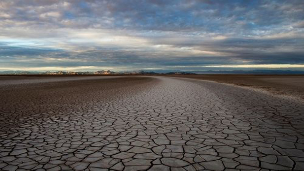 The Colorado River dies a slow death in Mexico. The river's delta, formerly lush, is now the mostly barren desert seen here. The river no longer reaches the Sea of Cortez.