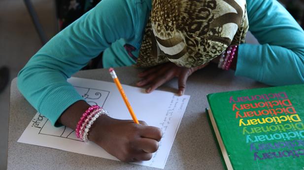 Holdiay Card writing student - spotlight
