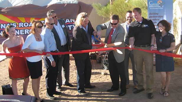 Picacho Peak, Arizona, Saturday, December 8, 2012: The official ribbon-cutting ceremony inaugurating the new GoE3 Quick Charging installation for EVs. (left to right) Ariel Brimacombe, Colleen Crowninshield (Tucson Clean Cities,) Bill Sheaffer (Phoenix Clean Cities,) Paul Bessent (VP, GoE3,) Bruce Brimacombe (CEO, GoE3,) Ken Bennett (AZ Secretary of State,) Colin Tetrault (Advisor on Sustainability, Phoenix Mayor's office,) Sean Hegna (Eaton Corporation,) Cyndi Brimacombe.