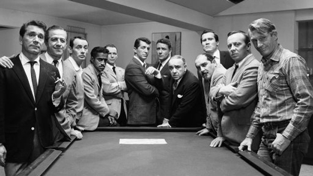 "Publicity shot of (L-R) Richard Conte as Anthony Bergdorf, Buddy Lester as Vince Massler, Joey Bishop as ""Mushy"" O'Connors, Sammy Davis Jr. as Josh Howard, Frank Sinatra as Danny Ocean, Dean Martin as Sam Harmon, Peter Lawford as Jimmy Foster, Akim Tamiroff as Spyros Acebos, Henry Silva as Roger Corneal, Richard Benedict as ""Curly"" Steffens, Norman Fell as Peter Rheimer, and Clem Harvey as Louis Jackson standing around the pool table."