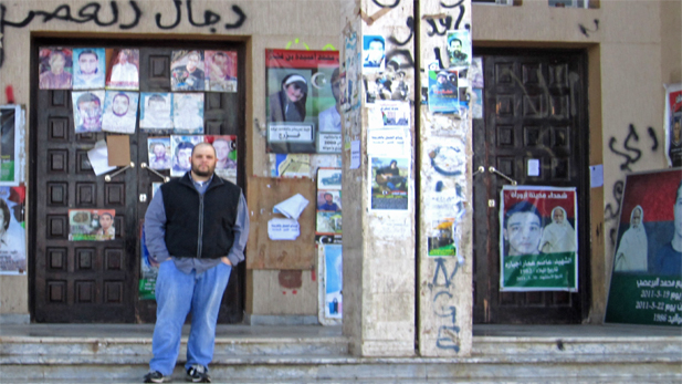 Tucsonan David Shellouff on his visit to Libya, with posters depicting martyrs of the Arab Spring.
