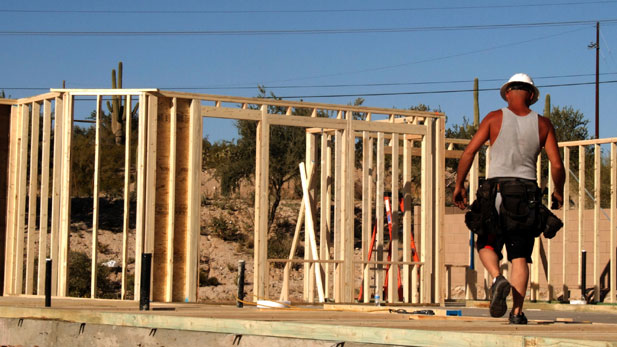 A man works on a housing construction site.