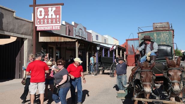 Tourists gather around a horse-drawn carriage in Tombstone.
