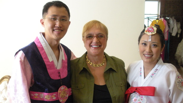 Celebrity chef, restaurateur, and culinary author Lidia Bastianich poses with a Korean-American couple on their wedding day.