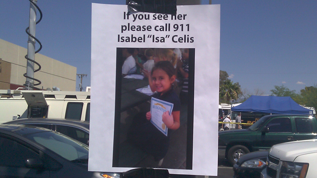 A poster taped to a light pole in a parking lot asks for the public's help in the case of missing Tucson 6-year-old Isabel Celis.