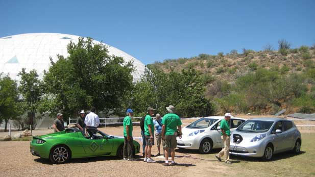 The Biosphere 2 Model City research facility in Oracle, Arizona: Saturday, April 21, 2012. Members of the Tucson Electric Vehicle Association, TEVA2, visit with Biosphere 2 staff and officials from GoE3, an Arizona-based company that has promised to deploy 500 of their modular quick chargers across US highways over the next 18 to 30 months. Two Nissan Leafs and a Tesla Roadster is also shown.