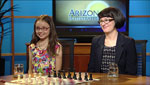 Varga Luna Michaud (left) an 8 year old chess fanatic and Jean Hoffman (right) the Executive Director of 9 Queens talks about the upcoming Chess Fest and how you could meet a Grand Master Chess player.