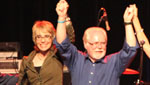 Gabrielle Giffords celebrates with Ron Barber as he hosts a concert for his campaign volunteers in the days leading up to the June 12 special election in Congressional District 8.