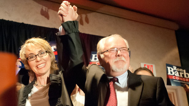 Democrat Ron Barber celebrates his win in Congressional District 8 with his former boss, Gabrielle Giffords.