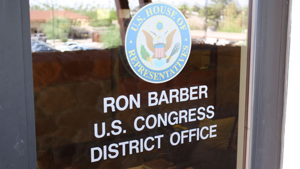 The front door to the Congressional District 8 office in Tucson reflects Democrat Ron Barber's victory two days after the special election to fill the vacant seat in Congress.
