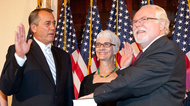 House Speaker John Boehner (R-Ohio) swears in Ron Barber (D-Arizona) June 19, 2012. Barber's wife, Nancy, joined them for the ceremony.