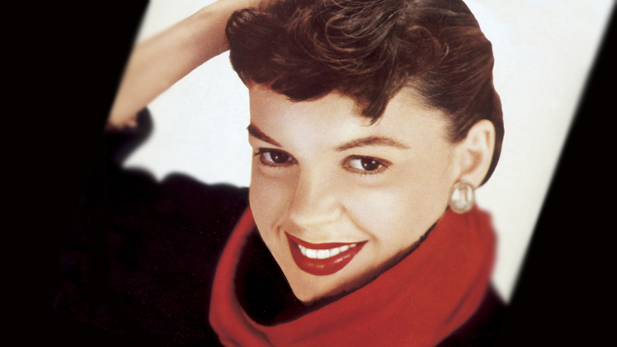 Judy Garland smiles in quiet pride while promoting her 1954 comeback film, A Star Is Born. The film won Garland an Academy Award nomination as Best Actress and — in a movie career that spanned 1929 to 1963 — stands as her quintessential motion picture showcase.