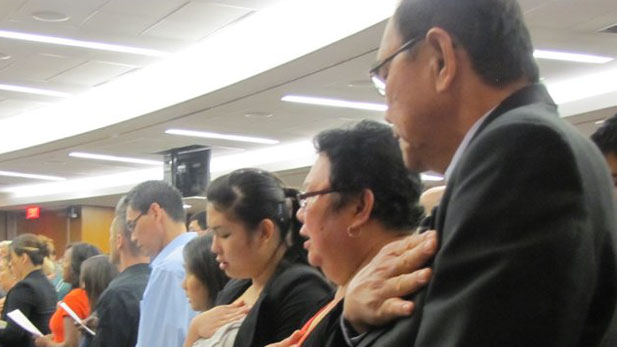 New U.S. citizens recite Pledge of Allegiance recently in Las Vegas.