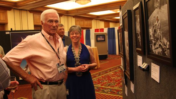 Apollo Astronaut Gene Cernan was the last man to walk on the moon. Here, he looks at lunar artwork with the artist, Pamela Lee in Tucson May 31, 2012.