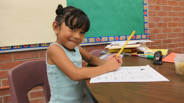 Five-year-old Isabella Goff-Quiroga working on a vocabulary lesson at the Jump Start summer program.
