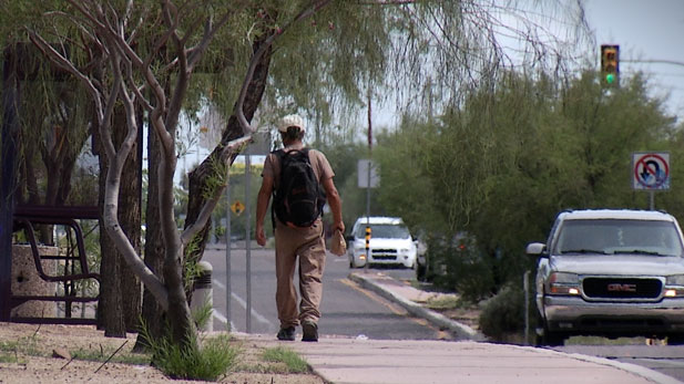 After spending some time at the Cooling Center, this homeless man is back on the streets.