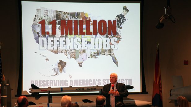 U.S. Sen. John McCain, R-Ariz., talks with Raytheon employees in Tucson about automatic budget cuts to the Department of Defense, set to go into effect Jan. 1, 2012.