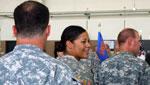 9/12/12. Rebecca Brukman. Female member of the National Guard smiles before departure.