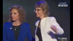Former U.S. Rep. Gabrielle Giffords, D-Ariz., appears at the September, 2012 Democratic National Convention to lead the delegates in the Pledge of Allegiance. She appears with U.S. Rep. Debbie Wasserman-Schultz, D-Fla.
