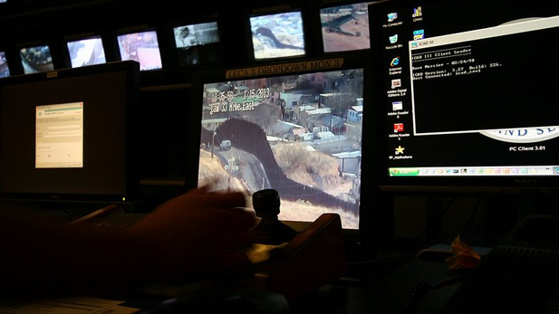 Border monitors in the Border Patrol's Nogales communications center.