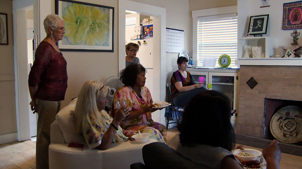 Jean Fedigan, executive director of the Sister José Shelter and some of the shelters residents, watch TV and take a break from the harsh life on the street.