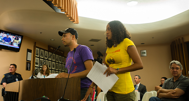 Leilani Clark, who said she was pepper sprayed at the Oct. 8 immigrant rights protest scene, prepares to address the City Council.