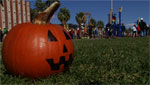 Students participate in the Tucson Pumpkin Toss, where they use physics and engineering to build trebuchets and catapults to hurl gourds through the air.
