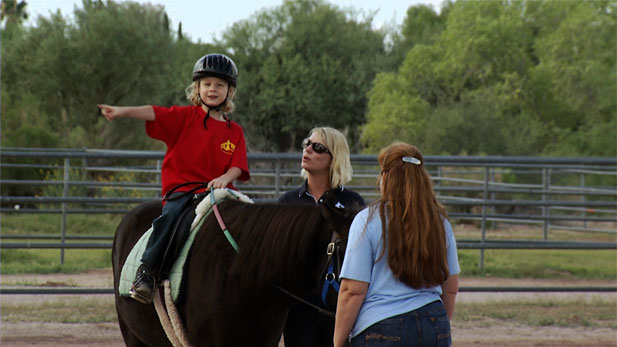 Alec Ring participates in TROT, a program using horse back riding to help with physical disabilities and mental and emotional challenges.