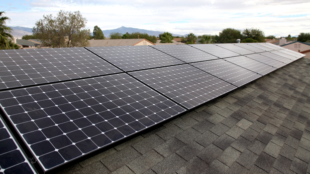 The 25-panel solar power system set-up of the roof of Enrique Ward's home.