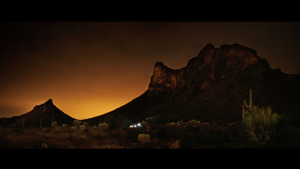 A time lapse photograph of light pollution from Tucson reaching the Picacho Peak night sky.