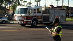 A Tucson fire truck arrives on the scene of a car accident.