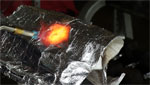 A company is designing new fire shelters that can withstand ten times the heat of fire shelters used today.